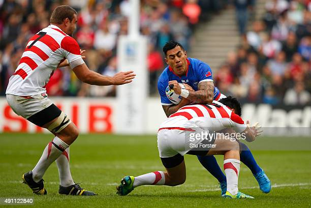 Tusi Pisi of Samoa is tackled by Harumichi Tatekawa of Japan during the 2015 Rugby World Cup Pool B match between Samoa and Japan at Stadium mk on...