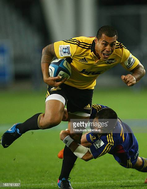 Tusi Pisi of the Hurricanes is tackled during the round five Super Rugby match between the Highlanders and the Hurricanes at Forsyth Barr Stadium on...