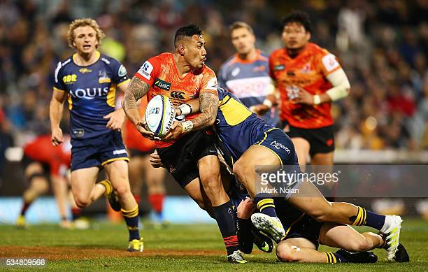Tusi Pisi of the Sunwolves looks for support during the round 14 Super Rugby match between the Brumbies and the Sunwolves at GIO Stadium on May 28...
