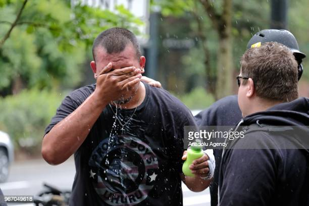 Tusitala Tiny Toese washes pepper spray out of his eyes after a scuffle with antifascist counterprotesters on June 03 2018 in Portland Oregon United...
