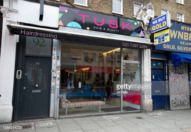 Tusk Hair Salon opens in Camden on July 04, 2020 in London, England. Hairdressing Salons reopen today having been closed for over three months in the...