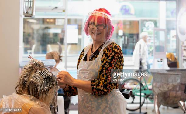 Tusk Hair Salon owner and hairdresser Carole Rickaby colours her client's hair in Camden on July 04, 2020 in London, England. Hairdressing Salons...