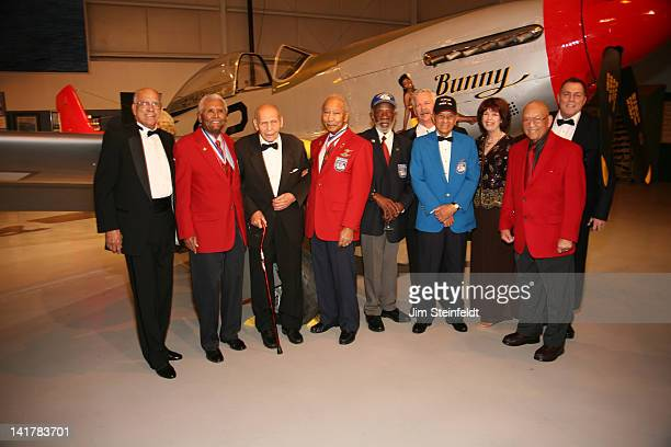 Tuskegee Airmen and friends pose for a protrait in front of a restored P-51 Airplane Rusty Burns, Asa Herring Jr., Alton Ballard, Robert Ashby, Ted...
