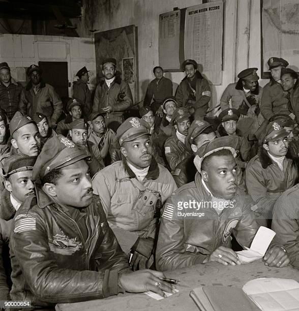 Tuskegee airmen attending a briefing First row 1 Hiram E Mann Cleveland OH Class 44F 2 Unidentified 3 Newman C Golden Cincinnati OH 44G 4 Bertram W...
