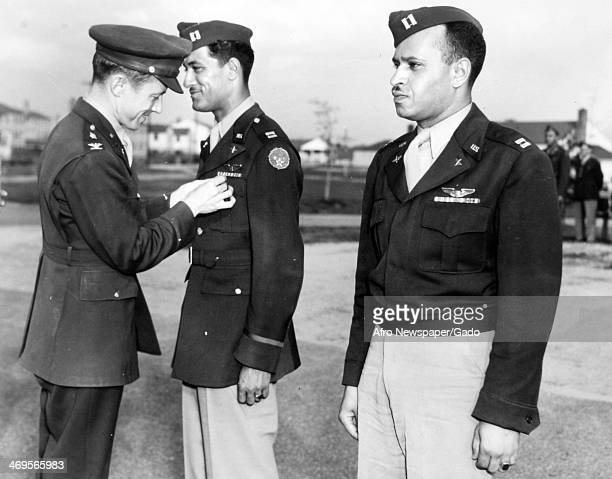 Tuskegee Airmen Captain Harold E Sawyer and Captain Hilton R Brooks receive the Distinguished Flying Cross from Colonel Noel F Parrish during World...