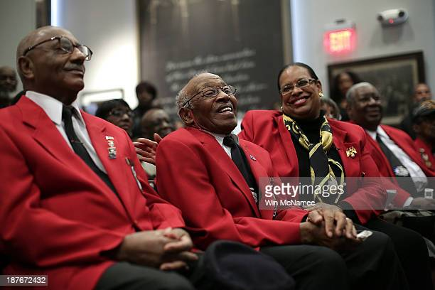 Tuskegee Airmen Ivan Ware and Edward Talbert take part in a ceremony commemorating Veterans Day and honoring the Tuskegee Airmen November 11 2013 in...