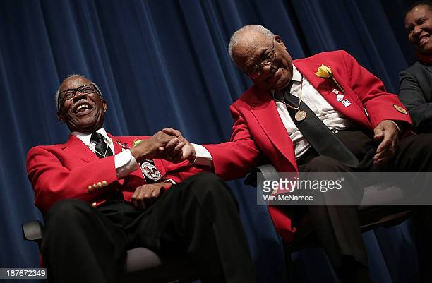 Tuskegee Airmen Major Anderson and William Fauntroy joke with each other during a ceremony commemorating Veterans Day and honoring the Tuskegee...