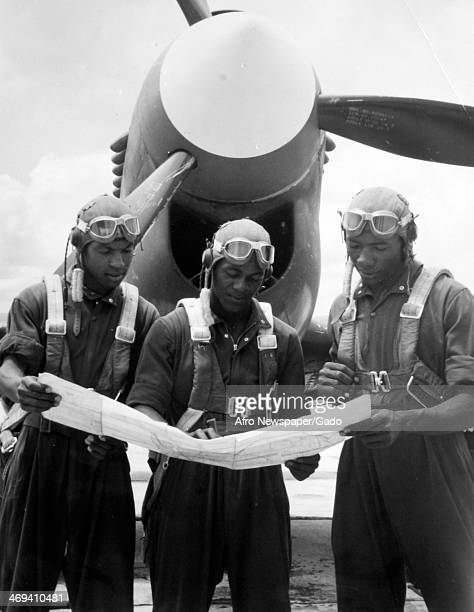 Tuskegee Airmen prepare for a flight from Tuskegee Army Airfield by reading a map Tuskegee Alabama 1943