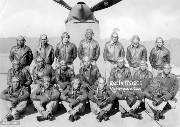 Tuskegee Airmen receiving their commissions at a parade at Tuskegee Army Airfield with an airplane in the background during World War 2 Tuskegee...