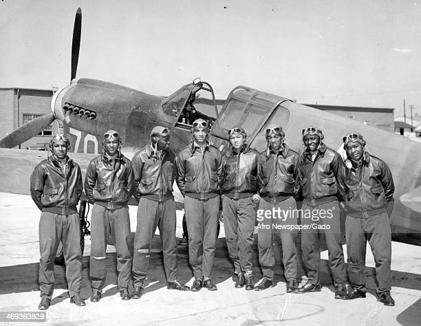 Tuskegee Airmen stand with an airplane and prepare to receive commissions and wings from Colonel Kimble Commanding Officer of the Tuskegee Army...