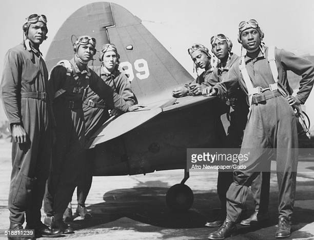 Tuskegee Airmen with fighter airplane at Tuskegee Army Flying School during World War 2 Tuskegee Alabama 1944