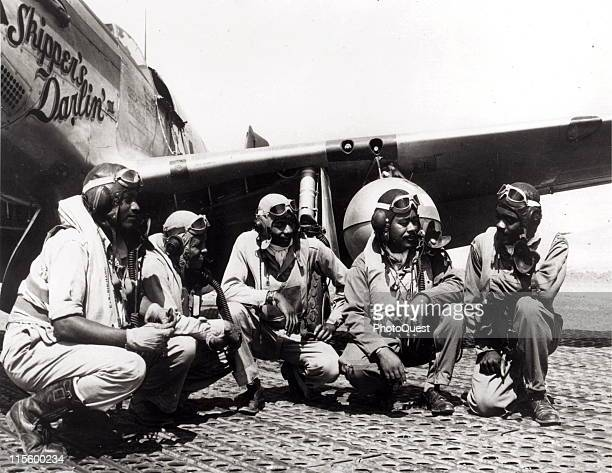 Tuskegee AirmenAugust 1944 Fliers of a P51 Mustang Group of the 15th Air Force in Italy shoot the breeze in the shadow of one of the Mustangs they...