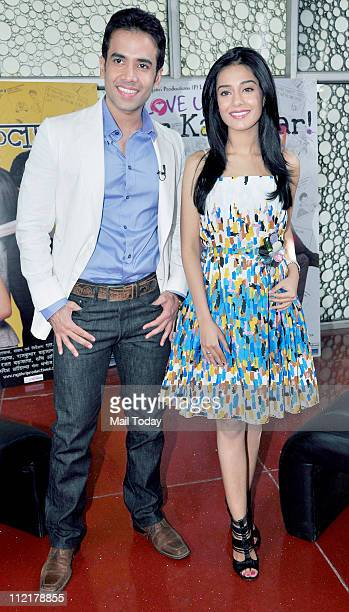 Tusshar Kapoor with Amrita Rao at the music launch of the film 'Love U Mr Kalakaar' at Cinemax Mumbai on 13th April 2011