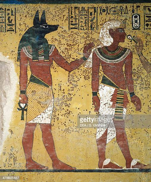 Tutankhamun being welcomed by Anubis and Hathor and offering them the ankh fresco south wall of the burial chamber Tomb of Tutankhamun Valley of the...