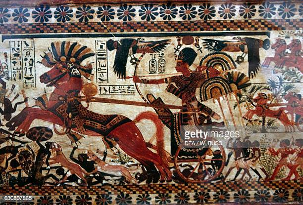 Tutankhamun driving a chariot wielding a bow and defeating the Nubians and Syrians casket of the Hunting in the Desert 13331323 BC Treasury of...