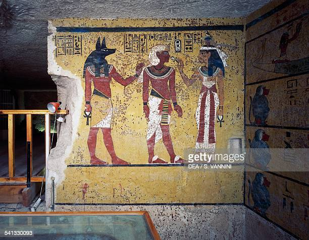 Tutankhamun flanked by god Anubis and goddess Hathor Hathor offering him life with the ankh Tomb of Tutankhamun Valley of the Kings Ancient Thebes...