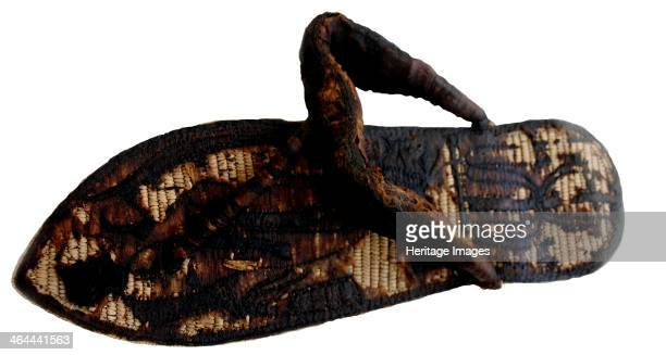 Tutankhamuns sandal decorated with bound prisoners and sematawy symbols 14th cen BC Found in the collection of the The Egyptian Museum Cairo