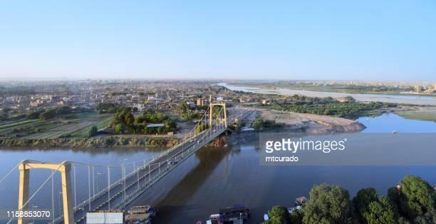 tuti bridge and tuti island, where the white nile and blue nile merge to form the main nile - khartoum, sudan - khartoum stock pictures, royalty-free photos & images