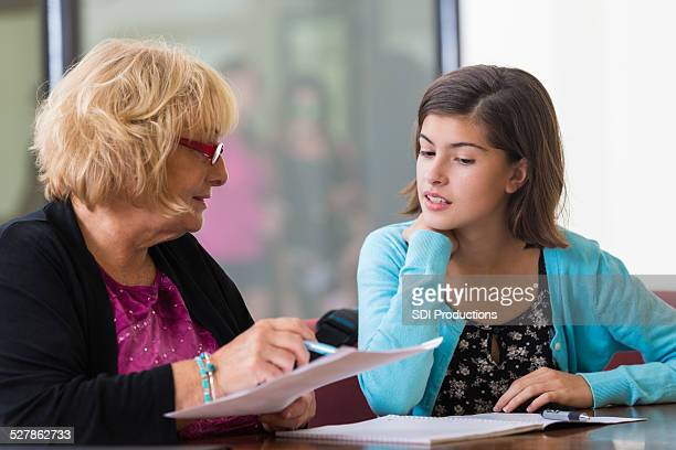 tutor or school counselor meeting with junior high student - cute highschool girls stock photos and pictures