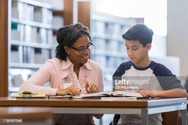 tutor working with middle school student - instructor stock pictures, royalty-free photos & images