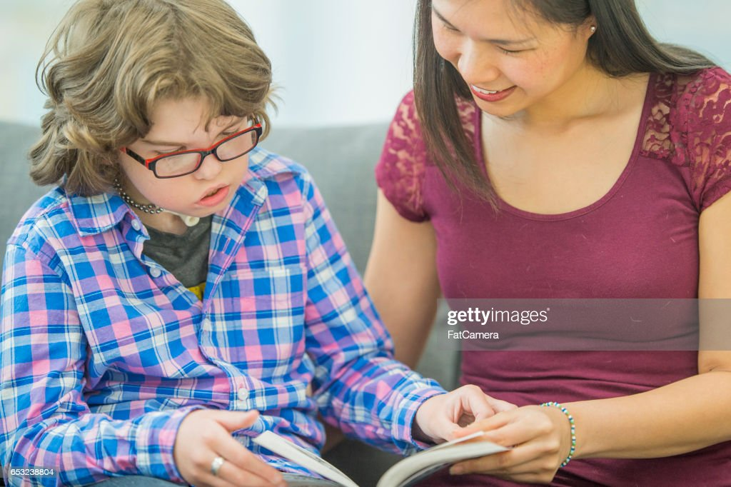 Tutoring a Child with a Learning Disability : Stock Photo