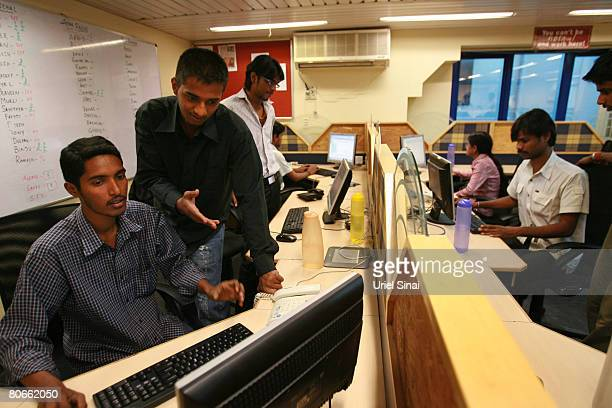 Tutors work at TutorVista headquarters in the early morning of April 13 2008 in Bangalore India India's successful IT industry is moving up from...
