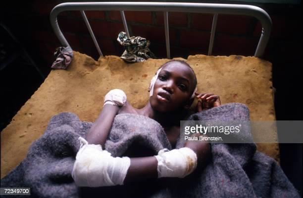 Tutsi survivor of the genocide in Rwanda lies in his bed at Gahini hospital in Rwanda May 11 1994 Hutu militias seeking to rid Rwanda of Tutsis...