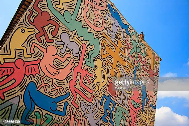 tuttomondo (keith haring mural), pisa, italy - pisa stock pictures, royalty-free photos & images