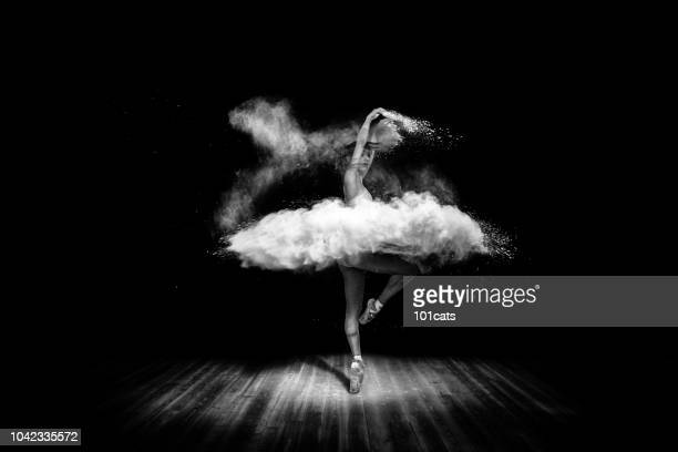 Tutu from powder. Beautiful ballet dancer, dancing with powder on stage