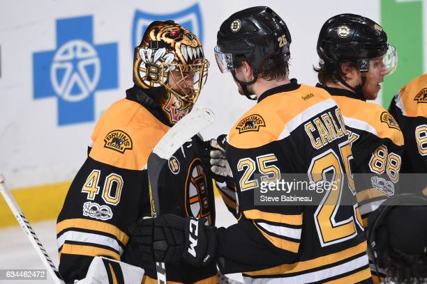 Tuukka Rask and Brandon Carlo of the Boston Bruins celebrate a win against the San Jose Sharks at the TD Garden on February 9 2017 in Boston...