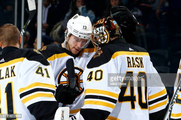 Tuukka Rask and Charlie Coyle of the Boston Bruins celebrate their teams 50 win over the New York Islanders at NYCB Live's Nassau Coliseum on March...