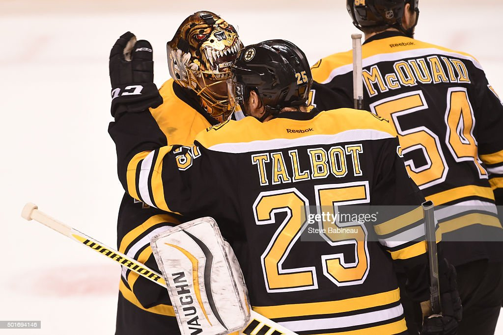 Tuukka Rask #40 and Max Talbot #25 of the Boston Bruins celebrate a shut out win against the Pittsburgh Penguins at the TD Garden on December 16, 2015 in Boston, Massachusetts.