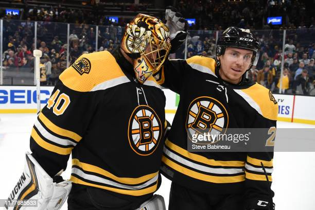 Tuukka Rask and Par Lindholm of the Boston Bruins celebrate the win against the Toronto Maple Leafs at the TD Garden on October 22 2019 in Boston...