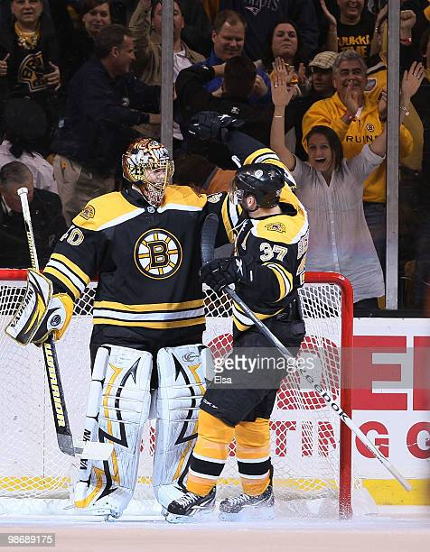 Tuukka Rask and Patrice Bergeron of the Boston Bruins celebrate the win over the Buffalo Sabres in Game Six of the Eastern Conference Quarterfinals...