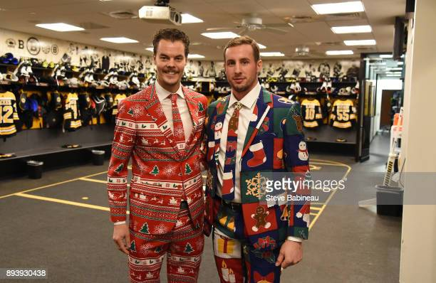Tuukka Rask and Tim Schaller of the Boston Bruins wear festive holiday suits before the game against the New York Rangers at the TD Garden on...