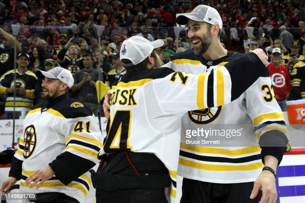 Tuukka Rask and Zdeno Chara of the Boston Bruins celebrate after defeating the Carolina Hurricanes in Game Four to win the Eastern Conference Finals...