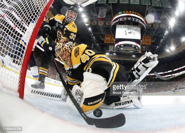 Tuukka Rask and Zdeno Chara of the Boston Bruins stop a shot against the St Louis Blues during the second period in Game Seven of the 2019 NHL...