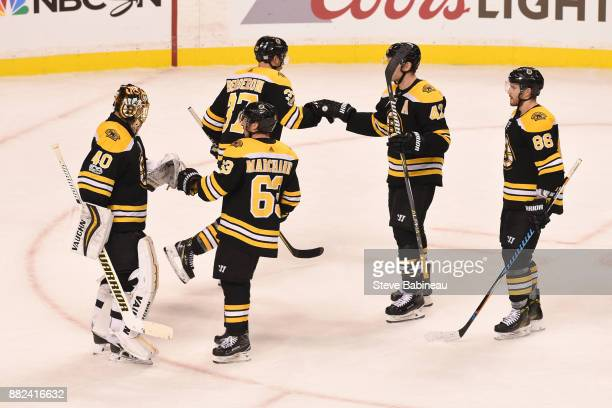 Tuukka Rask Brad Marchand Patrice Bergeron David Backes and Kevan Miller of the Boston Bruins celebrate a win against the Tampa Bay Lightning at the...