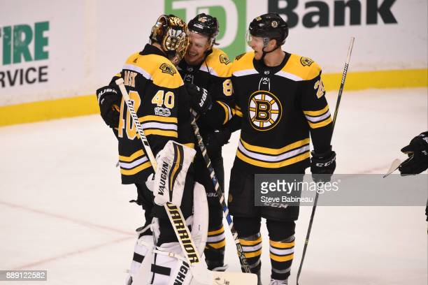 Tuukka Rask David Pastrnak and Riley Nash of the Boston Bruins celebrate a win against the New York Islanders at the TD Garden on December 9 2017 in...