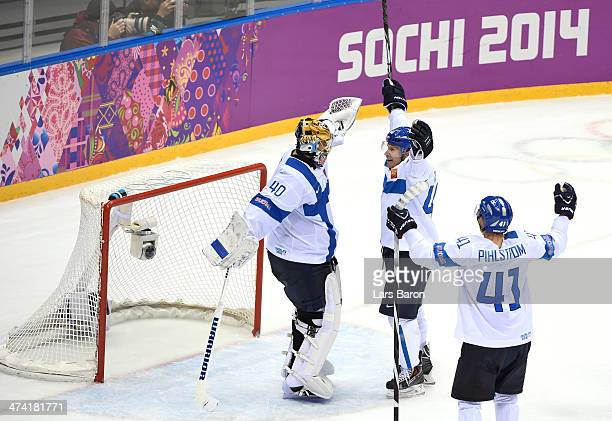 Tuukka Rask Kimmo Timonen and Antti Pihlstrom of Finland celebrate after defeating the United States 50 during the Men's Ice Hockey Bronze Medal Game...