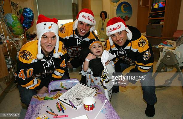 Tuukka Rask Nathan Horton and Marc Savard of the Boston Bruins spread holiday cheer to Caleb at Children's Hospital Boston on December 21 2010 in...