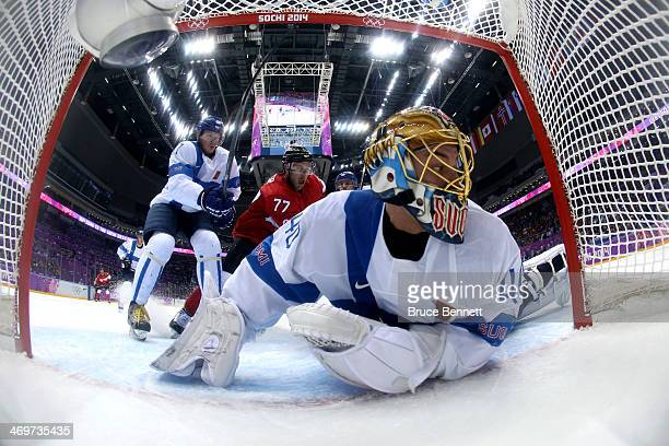 Tuukka Rask of Finland makes a save against Jamie Benn of Canada in the first period during the Men's Ice Hockey Preliminary Round Group B game on...