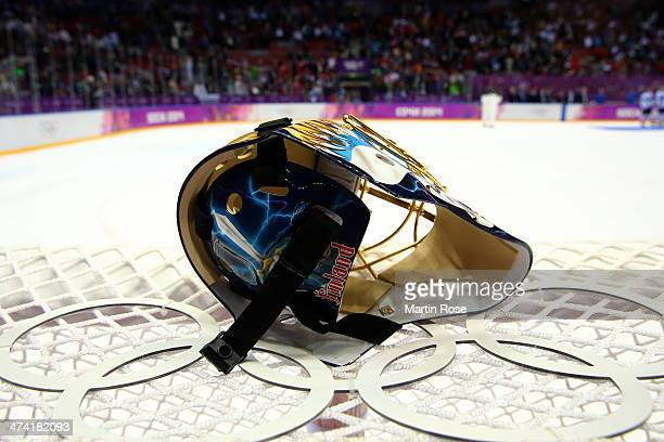 Tuukka Rask of Finland's helmet sits on top of the net after defeating the United States 50 during the Men's Ice Hockey Bronze Medal Game on Day 15...