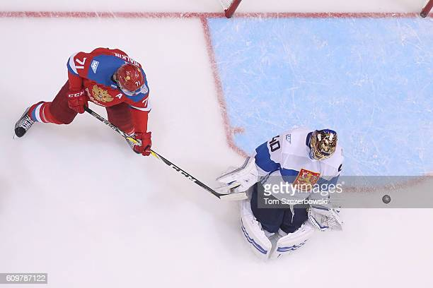 Tuukka Rask of Team Finland makes a save as Evgeni Malkin of Team Russia stations himself in front of the net during the World Cup of Hockey...