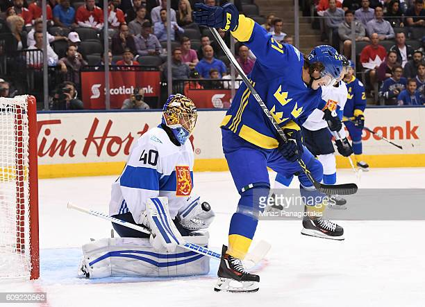 Tuukka Rask of Team Finland makes a save with Loui Eriksson of Team Sweden creating traffic in front during the World Cup of Hockey 2016 at Air...
