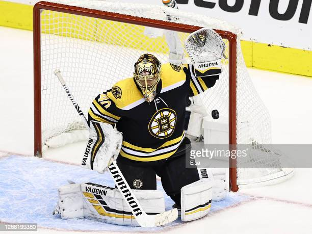 Tuukka Rask of the Boston Bruins allows a goal to Dougie Hamilton of the Carolina Hurricanes during the third period in Game Two of the Eastern...