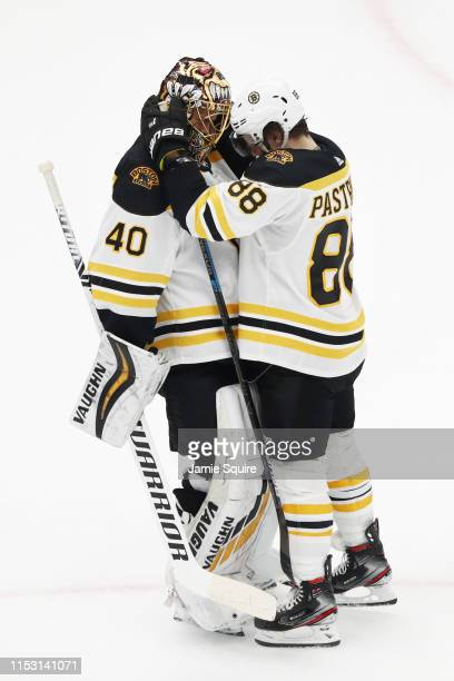 Tuukka Rask of the Boston Bruins and David Pastrnak celebrate their 72 win over the St Louis Blues in Game Three of the 2019 NHL Stanley Cup Final at...