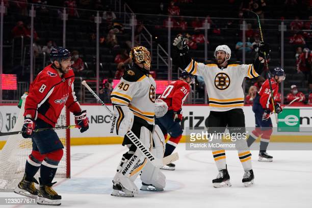 Tuukka Rask of the Boston Bruins celebrates with his teammate Jarred Tinordi after the Bruins defeated the Washington Capitals 3-1 in Game Five of...