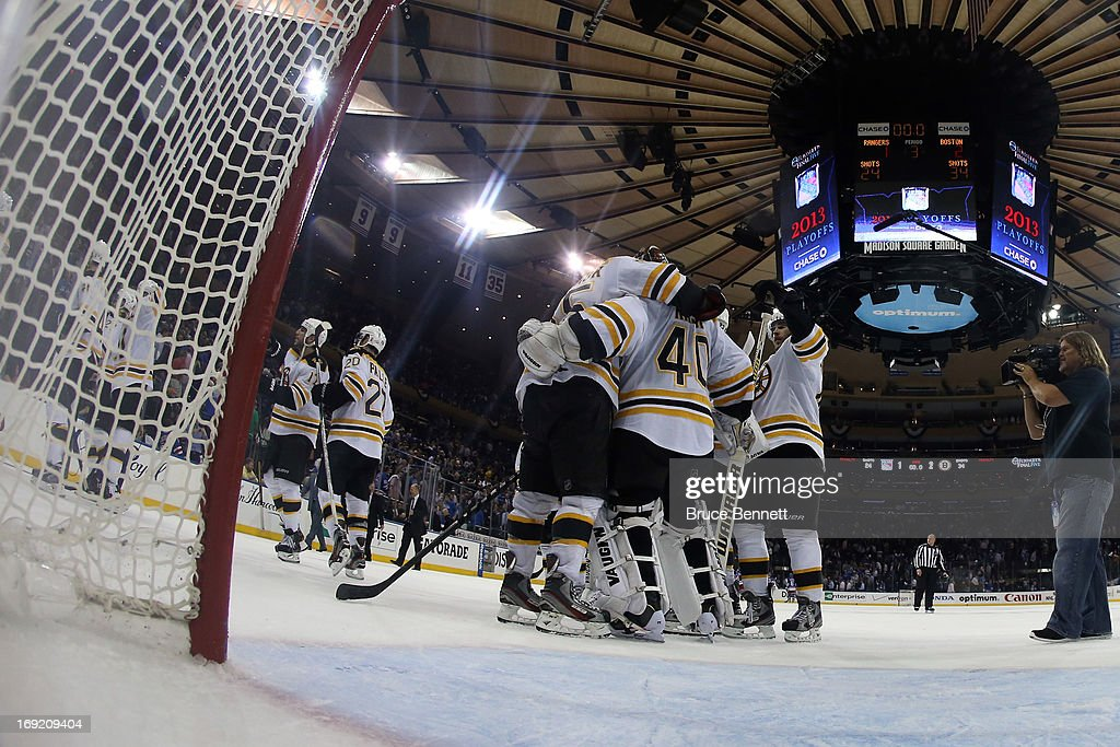 Tuukka Rask #40 of the Boston Bruins celebrates with his teammates after defeating the New York Rangers in Game Three of the Eastern Conference Semifinals during the 2013 NHL Stanley Cup Playoffs at Madison Square Garden on May 21, 2013 in New York City. The Boston Bruins defeated the New York Rangers 2-1.