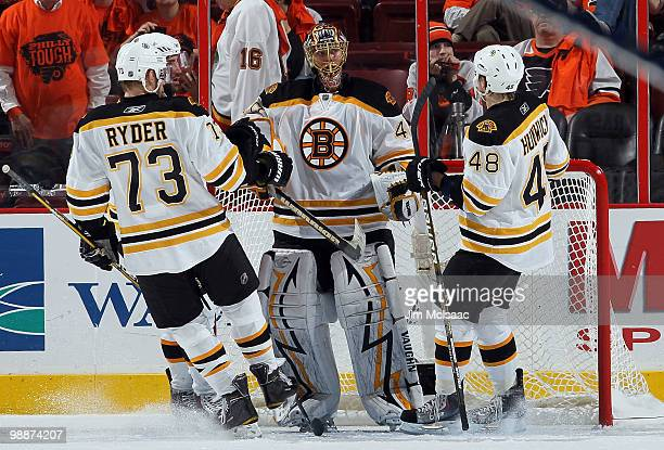 Tuukka Rask of the Boston Bruins celebrates with his teammates after defeating the Philadelphia Flyers in Game Three of the Eastern Conference...